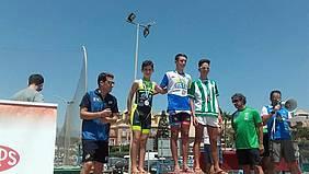 Imagen en el pódium de los tres vencedores.